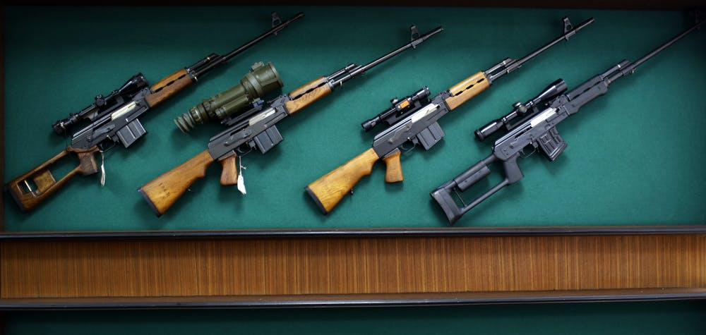 """Rifles are displayed in the exhibition hall of the """"Zastava Arms"""" weapons factory in the Serbian town of Kragujevac, some 137km (85 miles) from capital Belgrade, May 8, 2013. Now, knocking on the door of the European Union, one industry in Serbia is leading the way where others have been ravaged by a painful transition to capitalism: guns. Serbia is clawing back old markets for its weapons and ammunition in Africa and the Middle East and former arch foe the U.S., which led the 1999 NATO air war against Slobodan Milosevic. In a country of 25 percent unemployment, weapons producers are adding workers year after year with the value of export contracts now pushing $300 million annually, according to state weapons' exporter Yugoimport-SDPR. Picture taken May 8, 2013. REUTERS/Marko Djurica (SERBIA - Tags: BUSINESS MILITARY)"""