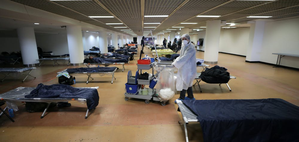 Homeless people sleep inside the Festival palace as Cannes Mayor David Lisnard decided to open a part of the palace to welcome needy and homeless as a lockdown is imposed to slow the rate of the coronavirus disease (COVID-19) in France, March 24, 2020.