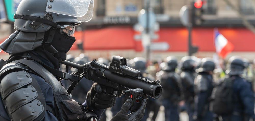 "Police officers use their LBD-40 rifle (FLashball type) to keep the crowd at bay. Several thousand people claiming to be part of the so-called Yellow Jackets ("" Gilets Jaunes "") movement took part in the demonstration of Act 13 in the streets of Paris. The demonstration took place between the Champs-ElysÈes and the Champ de Mars with many acts of violence along the way. Paris, France, February 9, 2019. Photo by Samuel Boivin/ABACAPRESS.COM"
