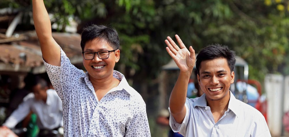 Reuters reporters Wa Lone and Kyaw Soe Oo gesture as they walk free outside Insein prison after receiving a presidential pardon in Yangon, Myanmar, May 7, 2019. REUTERS/Myat Thu Kyaw TPX IMAGES OF THE DAY