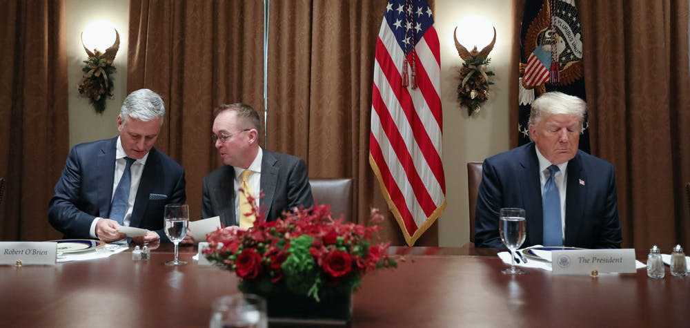 White House National Security Advisor Robert O'Brien and acting Chief of Staff Mick Mulvaney attend as U.S. President Donald Trump hosts a lunch for ambassdors to the U.N. Security Council at the White House in Washington, U.S. December 5, 2019.  REUTERS/Jonathan Ernst