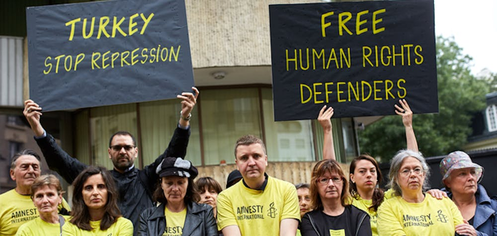 AI France staff membres protesting the arrest and detention of AI Turkey director Idil Eser, AI Turkey chairman Taner Kiliç and 9 orhers Human rights defenders at the Turkish embassy in Paris on 10 July 2017.