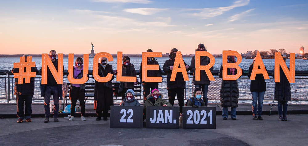 Activists from New York-based direct action group Rise and Resist and the International Campaign to Abolish Nuclear Weapons (ICAN) took to the streets to announce the entry into force of the Treaty on the Prohibition of Nuclear Weapons on January 22, 2021 by holding illuminated letters that read #NUCLEARBAN in front of iconic New York landscapes.