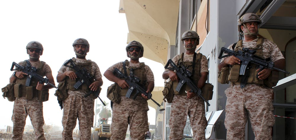 Soldiers from the United Arab Emirates stand guard at the airport of Yemen's southern port city of Aden August 8, 2015. Soldiers from the United Arab Emirates, at the head of a Gulf Arab coalition fighting Iran-allied Houthi forces in Yemen, are preparing for a long, tough ground war from their base in the southern port of Aden. Picture taken August 8, 2015.