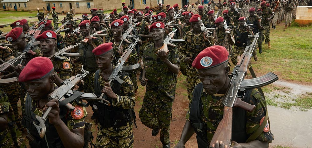 Personnel of the South Sudan People's Defence Forces (SSPDF), formerly named Sudan People's Liberation Army (SPLA), assigned as South Sundan's presidential guard, take part in a drill at their barracks in Rejaf, about 15km south of Juba, South Sudan, on April 26, 2019. - Though the guard is supposed to be comprised of an even share of former SPLA soldiers and former Sudan People's Liberation Army in Opposition (SPLA-IO) soldiers, the two armies have still not commenced training together despite the deadline for the formation of a unity government fast approaching on May 12. (Photo by Alex McBride / AFP) (Photo credit should read ALEX MCBRIDE/AFP via Getty Images)
