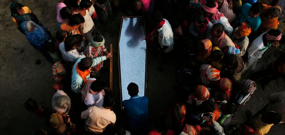 Mandatory Credit: Photo by Niranjan Shrestha/AP/Shutterstock (7647243a) Relatives and villagers gather around the coffin of Balkisun Mandal Khatwe at Belhi village, Saptari district of Nepal. Balkisun, who had been working for Habtoor Leighton Group in Qatar for less than a month, died in his sleep. The number of Nepali workers going abroad has more than doubled since the country began promoting foreign labor in recent years: from about 220,000 in 2008 to about 500,000 in 2015. Yet the number of deaths among those workers has risen much faster in the same period. In total, over 5,000 workers from this small country have died working abroad since 2008, more than the number of U.S. troops killed in the Iraq War Nepal Migrant Deaths - 23 Nov 2016