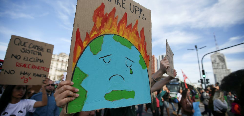 Activists hold placars as they participate in a Fridays for Future march calling for urgent measures to combat climate change in Buenos Aires, Argentina, September 27, 2019. REUTERS/Agustin Marcarian