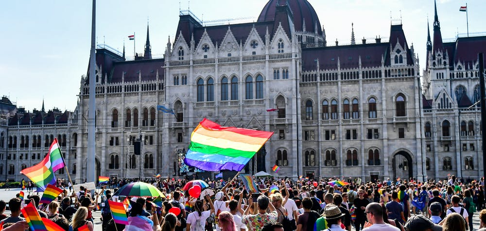 People march to the parliament building during the lesbian, gay, bisexual and transgender (LGBT) Pride Parade in Budapest, Hungary on July 7, 2018. GERGELY BESENYEI / AFP