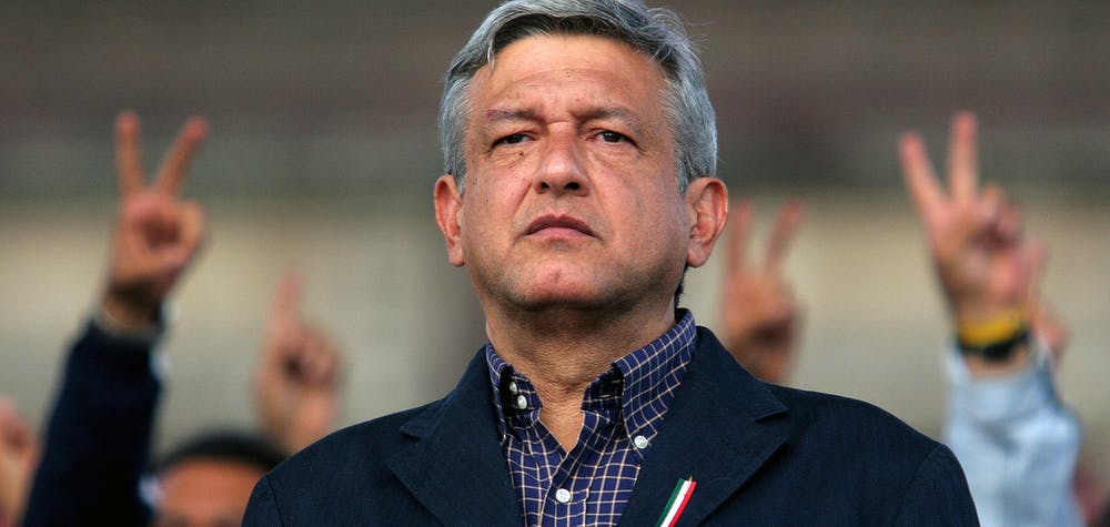 Andres Manuel Lopez Obrador, presidential candidate of the Party of the Democratic Revolution (PRD), looks at his supporters in central Zocalo Square, Mexico City August 5, 2006. Obrador angrily vowed to push ahead with street protests that have paralyzed the capital after a top court on Saturday rejected his demand for a full recount in a presidential vote he says was stolen from him. REUTERS/Tomas Bravo (MEXICO)
