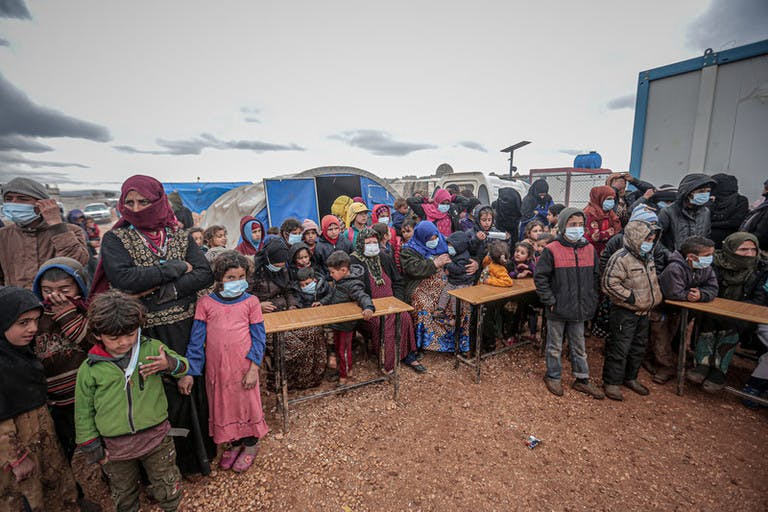 IDLIB, SYRIA - MARCH 18 : People, mostly children, wear masks as a preventive measure against coronavirus (Covid-19) as Idlib Health Directorate and Civil Defense Crews along with local charities carry out disinfection works at schools and tent cities in Idlib, Syria on March 18, 2020.