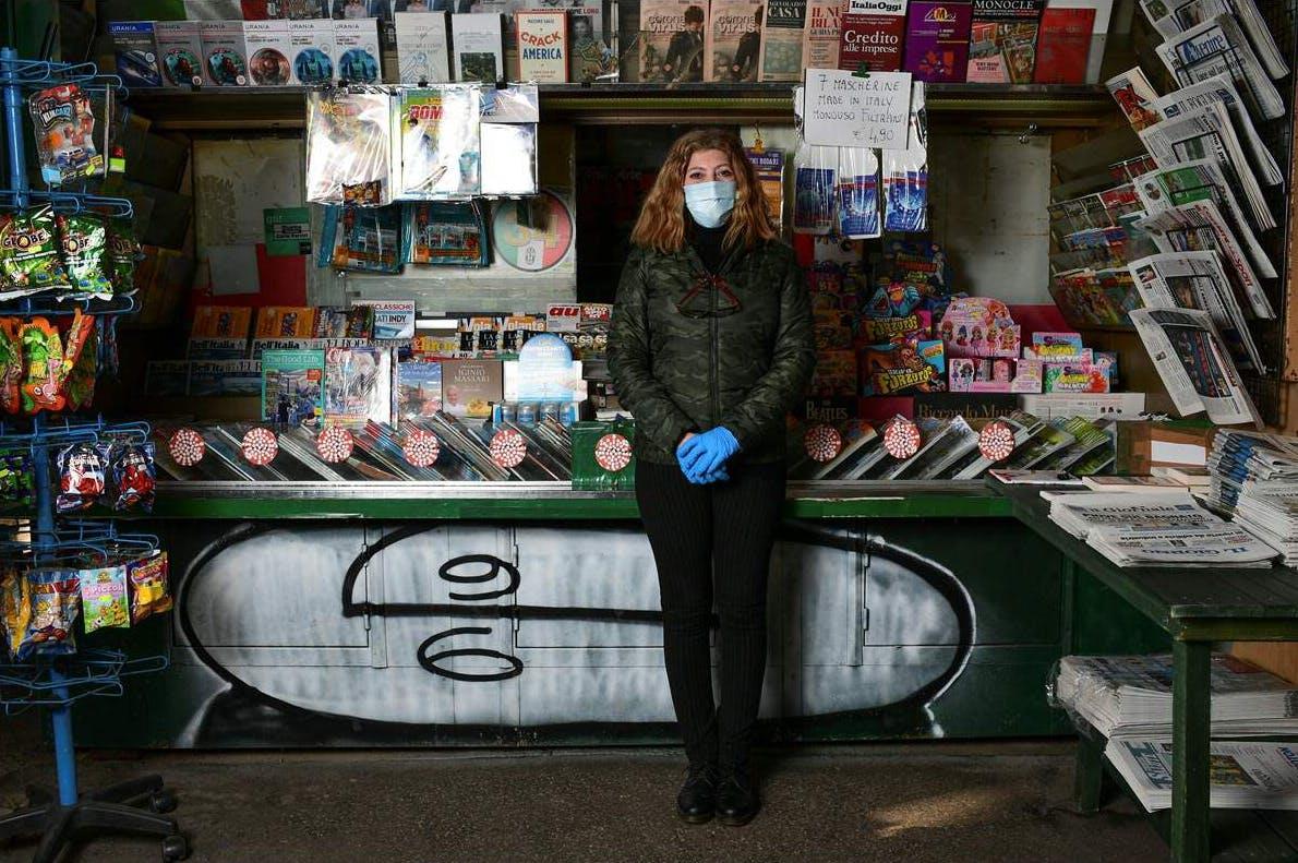 Italian Rosy Varrella, 55, newspapers kiosk owner, in Milan, Italy, on April 23, 2020;