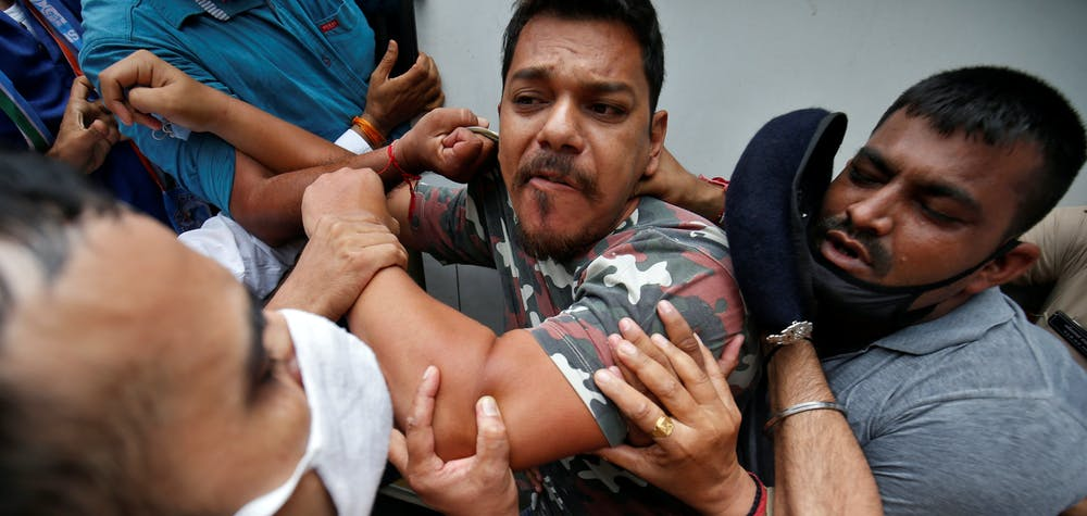An activist form India's main opposition Congress party is detained by police during a protest demanding postponement of admission tests to medical and engineering schools amidst the spread of the coronavirus disease (COVID-19), in Ahmedabad, India, August 28, 2020. REUTERS/Amit Dave