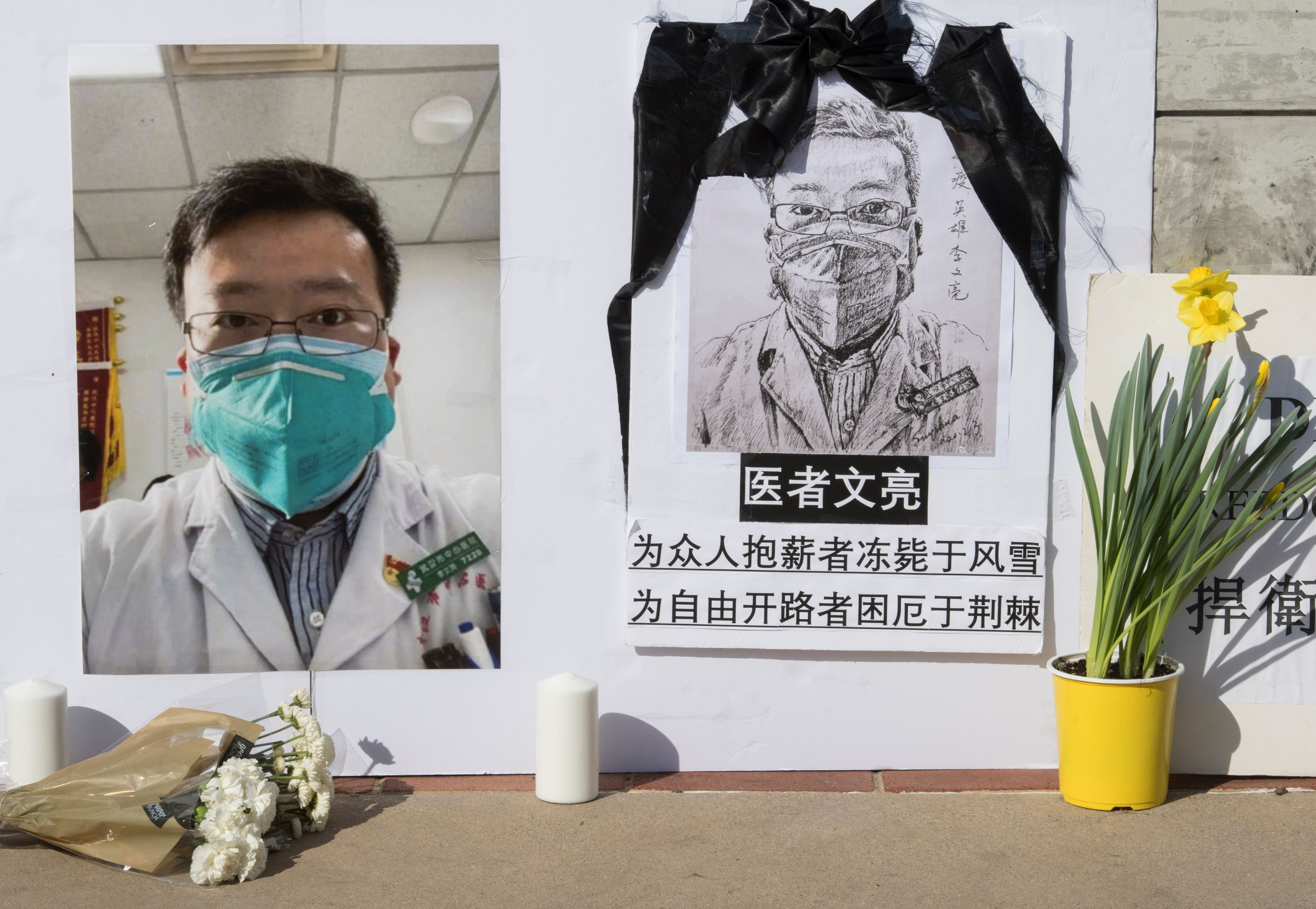 TOPSHOT - A memorial for Dr Li Wenliang, who was the whistleblower of the Coronavirus, Covid-19, that originated in Wuhan, China and caused the doctors death in that city, is pictured outside the UCLA campus in Westwood, California, on February 15, 2020. - The death toll from the new coronavirus outbreak surpassed 1,600 in China on Sunday, with the first fatality reported outside Asia fuelling global concerns. (Photo by Mark RALSTON / AFP) (Photo by MARK RALSTON/AFP via Getty Images)