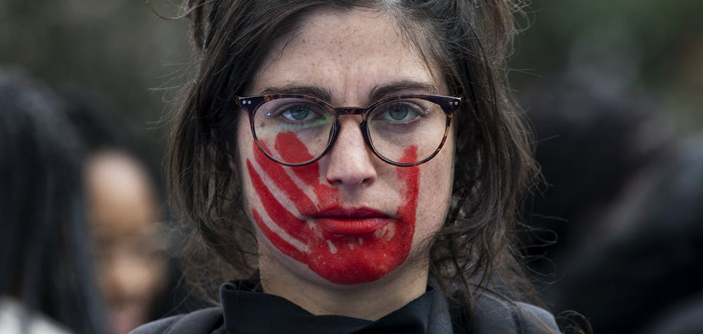 MADRID, SPAIN - MARCH 08: A woman wears red face paint depicting a hand during a protest during the International Women's Day on March 08, 2020 in Madrid, Spain. Spain celebrates International Women's Day today with countless protests scheduled throughout the day across the country in defense of their rights. Some of feminist movement's demands are equal working rights, women's right to abortion and an end to violence against women, to racism and to xenophobia across the globe. (Photo by Pablo Blazquez Dominguez/Getty Images)