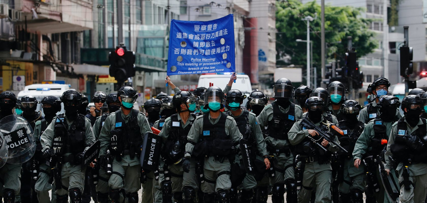 c2a95bfc-e769-47b4-87c0-a01231aae2e9_Hongkong-police.JPG?auto=compress,format&rect=0,210,4795,2283&w=1680&h=800