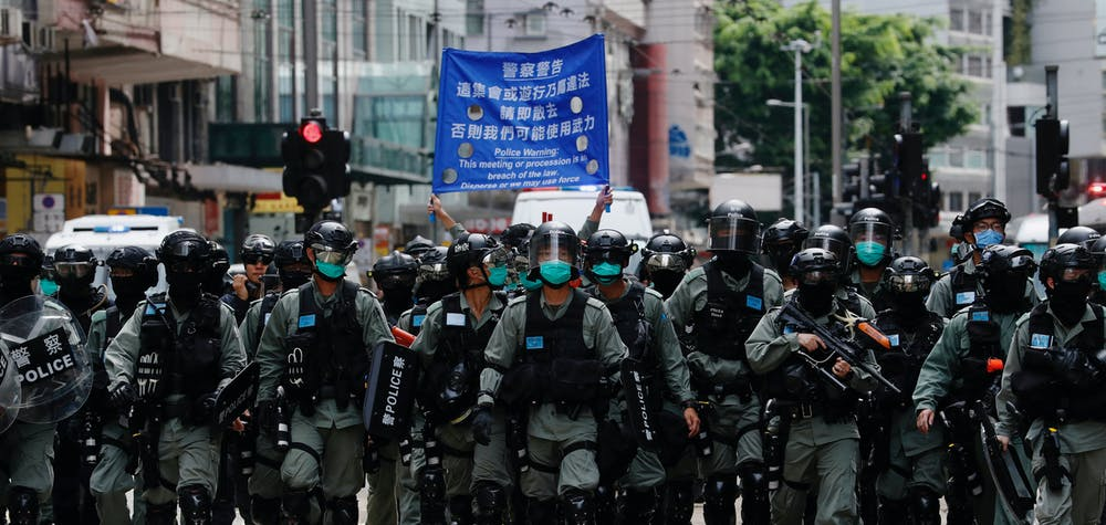 Riot police officers walk as anti-national security law protesters march during the anniversary of Hong Kong's handover to China from Britain, in Hong Kong, China July 1, 2020. REUTERS/Tyrone Siu  REFILE - CORRECTING YEAR