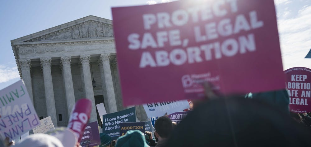 WASHINGTON, DC - MARCH 04: People participate in an abortion rights rally outside of the Supreme Court as the justices hear oral arguments in the June Medical Services v. Russo case on March 4, 2020 in Washington, DC. The Louisiana abortion case is the first major abortion case to make it to the Supreme Court since Donald Trump became President. Sarah Silbiger/Getty Images/AFP  Sarah Silbiger / GETTY IMAGES NORTH AMERICA / Getty Images via AFP