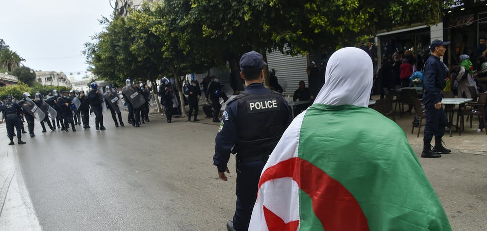 Algerian riot police gather during an anti-government demonstration in the capital Algiers on March 14, 2020. (Photo by RYAD KRAMDI / AFP)