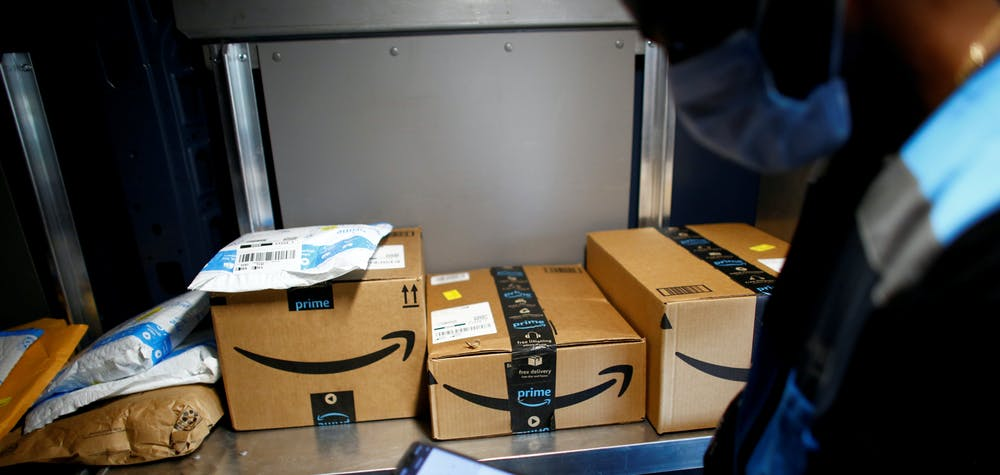An Amazon worker delivers packages amid the coronavirus disease (COVID-19) outbreak in Denver, Colorado, U.S., April 22, 2020. Picture taken April 22, 2020.