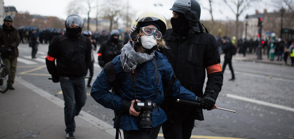 "A journalist arrested by police forces at the arc de triomphe during anti-government demonstration called by the Yellow Vest (Gilets Jaunes) movement in Paris on January 12, 2019. France braced for a fresh round of ""yellow vest"" protests across the country on with the authorities vowing zero tolerance for violence after weekly scenes of rioting and vandalism in Paris and other cities over the past two months. Photo by Raphael Lafargue/ABACAPRESS.COM"
