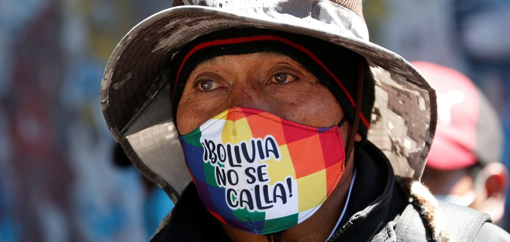 "A man with a face mask reading "" Bolivia does not shut up"" attends a rally demanding Bolivia's President Jeanine Anez's (not pictured) resignation, while the Bolivian Union Workers (COB) declare a pause to protests according to local media, amid the coronavirus disease (COVID-19), in El Alto, on the outskirts of La Paz, August 14, 2020. REUTERS/David Mercado"
