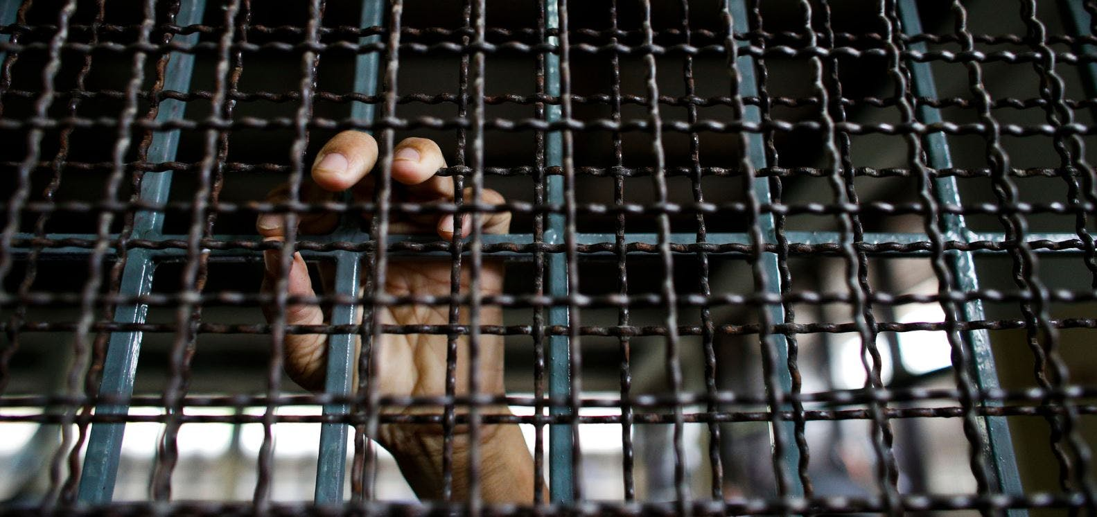 Un demandeur d'asile rohingya dans une cellule du centre de détention  pour migrants de la province de Kanchanaburi - Thaïlande 10/07/2013