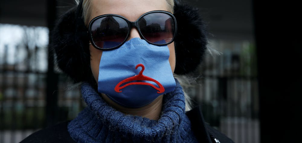An activist, wearing a protective mask amid the coronavirus disease (COVID-19) outbreak, protests against an initiative to tighten the nation's abortion rules in front of the Parliament in Warsaw, Poland April 15, 2020.