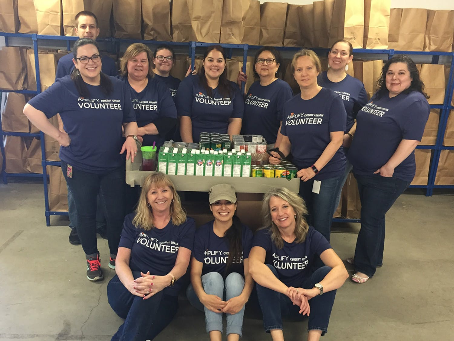 At Meals on Wheels, Amplify volunteers prepare groceries for delivery to Central Texans in need.