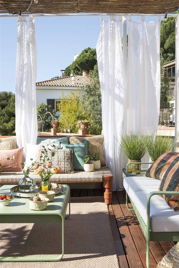 Terraza con textiles