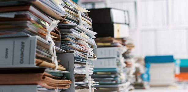 Piles of business records is a good sign you might need an accountant to make sense of it all