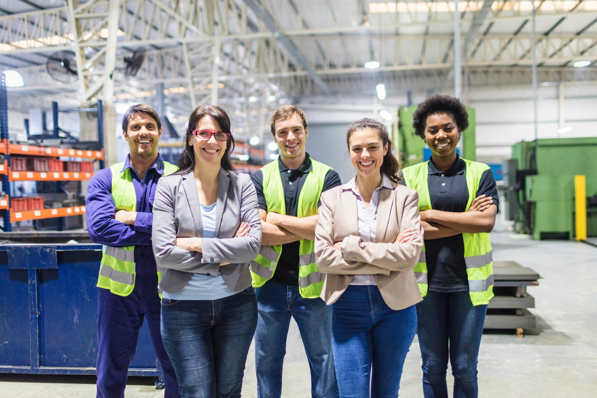 smiling team in warehouse