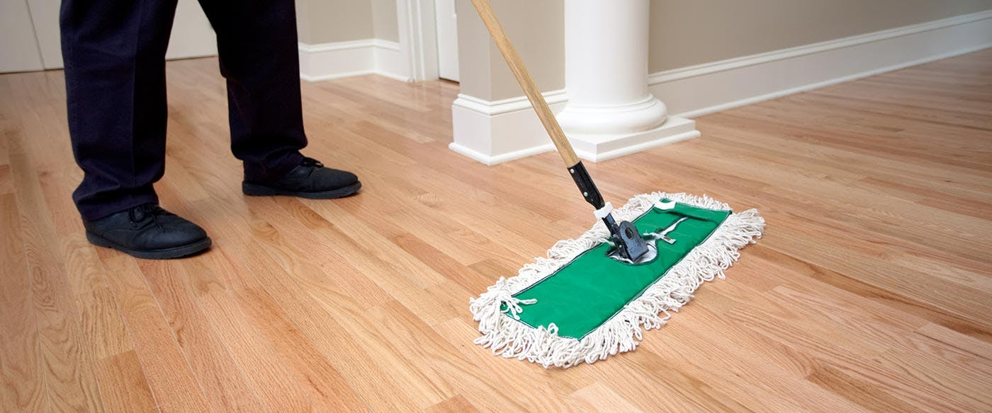 Cleaning a hardwood floor to prepare them to be refinished without sanding.