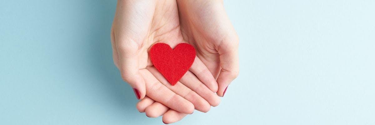 Egg donation - hands donating love, donating eggs.