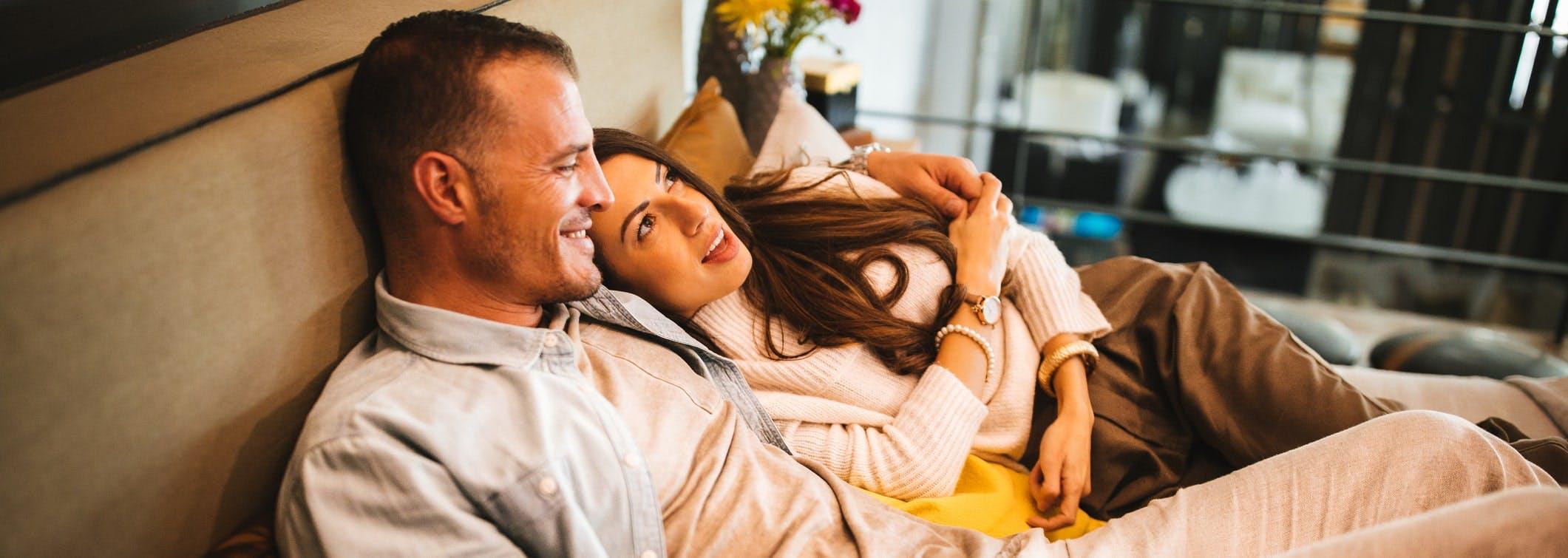 Couple on sofa - fertility treatment - IVF donor eggs
