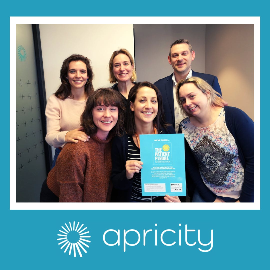 Apricity team holding Fertility Network Patient Pledge