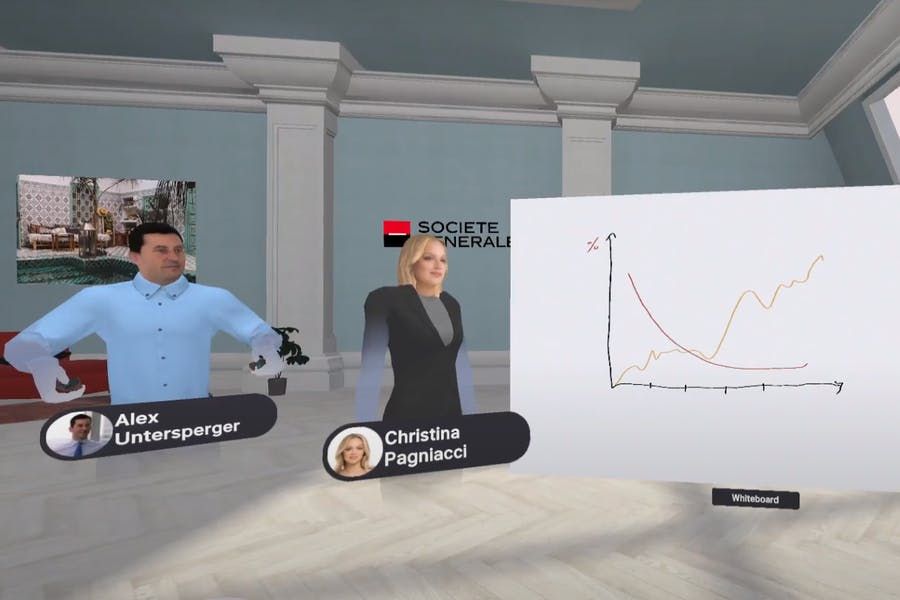 A male and a female avatar during a client discussion using whiteboard in an Arthur VR meeting