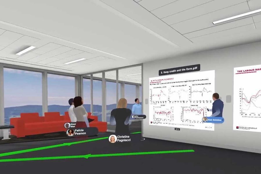 Avatars of a group of clients and company representatives discussing a presentation in Arthur VR meeting space