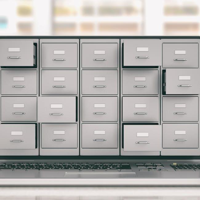 Szafa z szufladami na dokumenty obrazująca przechowywanie danych