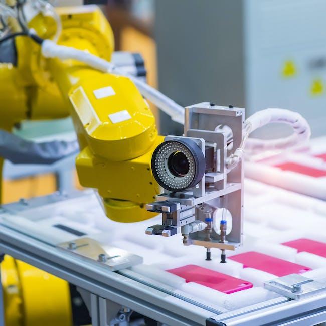 Cobot, robot współpracujący w kolorze żółtym