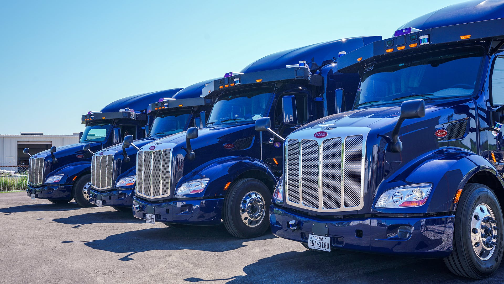 Autonomous trucks lined up at Aurora Illuminated