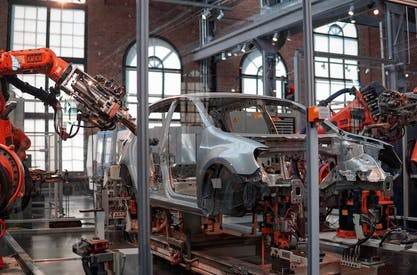 Car being assembled by robots
