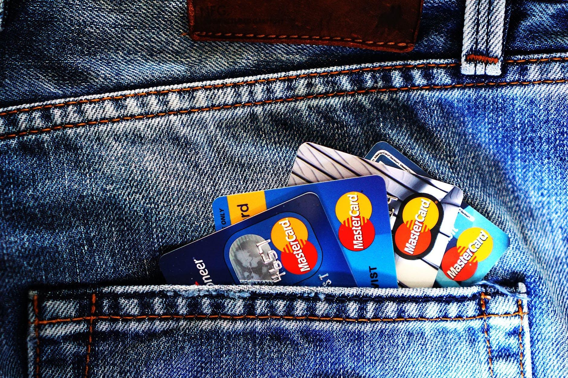 Credit cards in a jeans back pocket