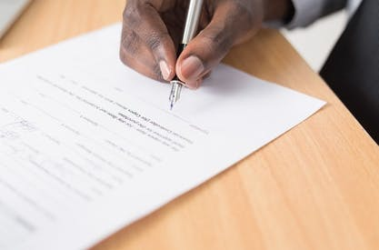 Man signing a contract agreement