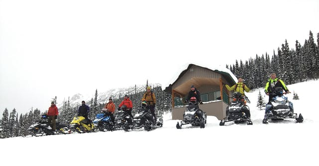 Board members for Avalanche Canada and the Avalanche Canada Foundation on snowmobiles in Valemount, BC.
