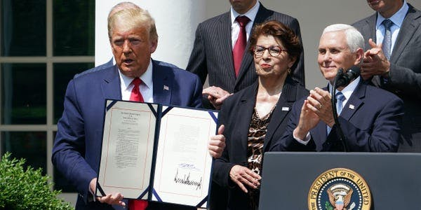 President Donald Trump signs a bill to extend the PPP small business lending program.