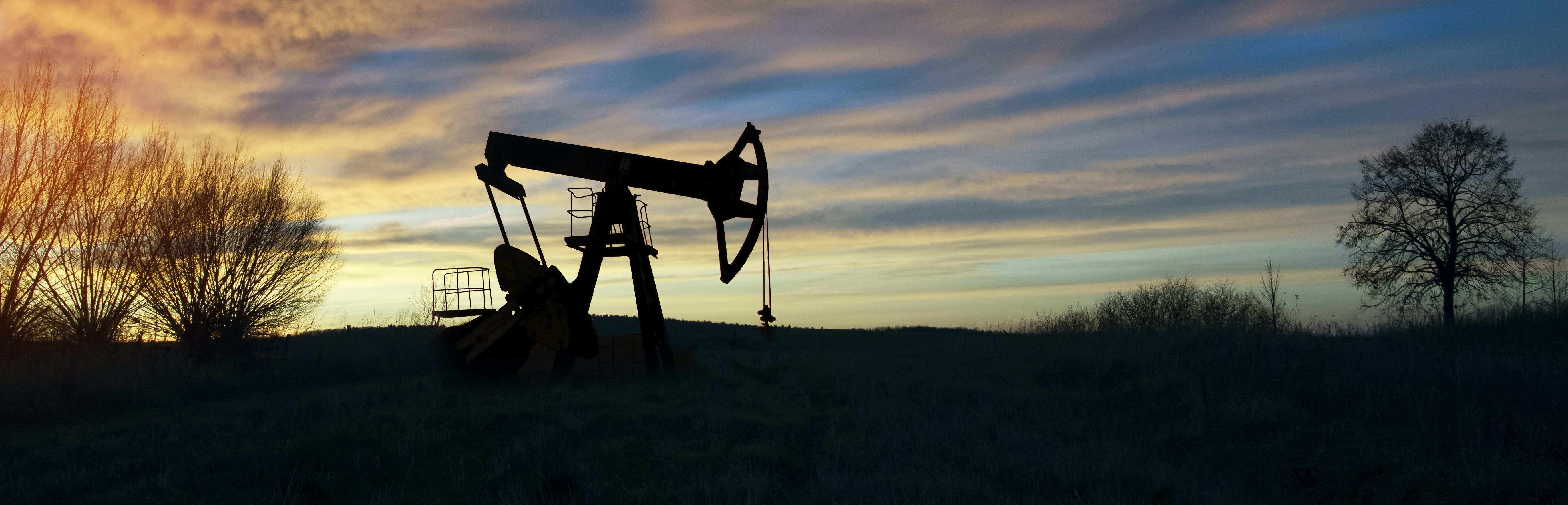 oil well drilling sunset fossil fuel