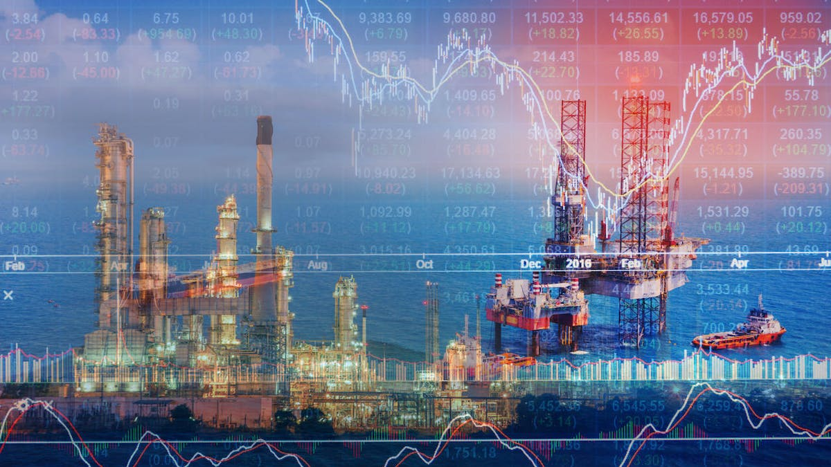 Image of offshore oil rigs spread with fiery stock charts superimposed on top.