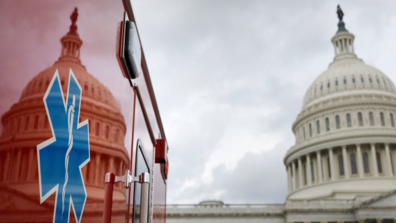 An ambulance parked next to the U.S. Capitol building.