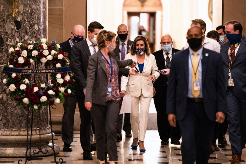 House Speaker Nancy Pelosi (D-Calif.), with reporters after speaking on the House floor at the Capitol in Washington, Thursday, Oct. 1, 2020.