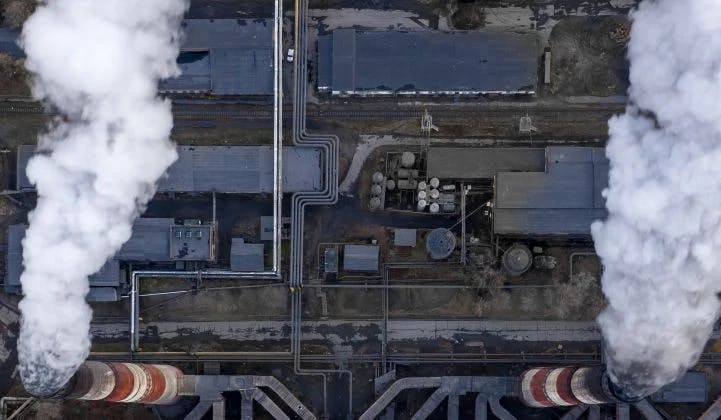 china abandoned coal plant with smoke